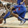 Oklahoma State \'s Le\'Bryan Nash (2) and Kansas\' Ben McLemore (23) fight for a loose ball during the college basketball game between the Oklahoma State University Cowboys (OSU) and the University of Kanas Jayhawks (KU) at Gallagher-Iba Arena on Wednesday, Feb. 20, 2013, in Stillwater, Okla. Photo by Chris Landsberger, The Oklahoman