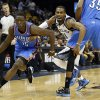 Oklahoma City\'s Reggie Jackson (15) drives past Memphis\' Mike Conley (11) as Oklahoma City\'s Kevin Durant (35) sets a screen during Game 3 in the second round of the NBA basketball playoffs between the Oklahoma City Thunder and Memphis Grizzles at the FedExForum in Memphis, Tenn., Saturday, May 11, 2013. Photo by Nate Billings, The Oklahoman