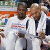 Oklahoma City\'s Kevin Durant and Derek Fisher talk on the bench during an NBA basketball game between the Oklahoma City Thunder and the New Orleans Pelicans at Chesapeake Energy Arena in Oklahoma City, Friday, April 11, 2014. Oklahoma City won 116-94. PHOTO BY BRYAN TERRY, The Oklahoman