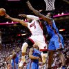 Miami\'s Dwyane Wade (3) goes past Oklahoma City\'s Serge Ibaka (9) during Game 5 of the NBA Finals between the Oklahoma City Thunder and the Miami Heat at American Airlines Arena, Thursday, June 21, 2012. Photo by Bryan Terry, The Oklahoman