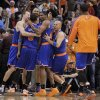 New York Knicks\' Jason Kidd, right, James White (4), Steve Novak, left, and Tyson Chandler, rear, celebrate with teammate J.R. Smith after Smith hit a game-winning basket against the Phoenix Suns during the second half of an NBA basketball game on Wednesday, Dec. 26, 2012, in Phoenix. The Knicks won 99-97. (AP Photo/Matt York)