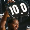 Photo - Kevin Durant holds up a score during filming of the Degree Men Alley-Oop Challenge at the Santa Fe Family Life Center on Monday. PHOTO BY JOHN CLANTON, THE OKLAHOMAN