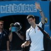Serbia\'s Novak Djokovic waves as he leaves Rod Laver Arena after defeating Radek Stepanek of the Czech Republic in their third round match at the Australian Open tennis championship in Melbourne, Australia, Friday, Jan. 18, 2013. (AP Photo/Dita Alangkara)