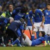 Photo - Italy's Riccardo Montolivo, lower right, is being treated after gettimg injured from a tackle during their international friendly soccer match at Craven Cottage, London, Saturday, May 31, 2014. (AP Photo/Sang Tan)