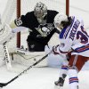 Photo - New York Rangers' Mats Zuccarello (36) cannot get a shot off in front of Pittsburgh Penguins goalie Marc-Andre Fleury (29) in the first period of an NHL hockey game in Pittsburgh, Friday, Jan. 3, 2014. (AP Photo/Gene J. Puskar)