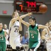 Okarche\'s Randi Hufnagel passes the ball over the head of Stonewall\'s Haley Snell during the girl\'s class A basketball playoffs at Southern Nazarene University\'s Sawyer Center in Bethany, OK, Thursday, March 1, 2012. By Paul Hellstern, The Oklahoman