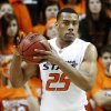 In this photo taken Jan. 26, 2011, Oklahoma State forward Darrell Williams is pictured during an NCAA college basketball game against Texas in Stillwater, Okla. Williams has been charged with a felony count of sexual battery and three felony counts of rape by instrumentation. The Payne County District Attorney\'s office filed the charges Monday, Feb. 7, 2011, against Williams. (AP Photo/Sue Ogrocki)