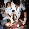 Photo -   In this photo released by China's Xinhua News Agency, a survivor gets first aid after he was rescued at Xiaojiawan Coal Mine in Panzhihua City, southwest China's Sichuan Province, Thursday, Aug. 30, 2012. A gas explosion at the mine killed over a dozen miners and trapped dozens more, state media reported Thursday. (AP Photo/Xinhua, Zhang Zhong) NO SALES