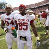 Oklahoma\'s Ryan Broyles (85) and Oklahoma\'s Eric Hosek (94) walk off the field after the Red River Rivalry college football game between the University of Oklahoma Sooners (OU) and the University of Texas Longhorns (UT) at the Cotton Bowl in Dallas, Saturday, Oct. 8, 2011. Oklahoma won 55-17. Photo by Bryan Terry, The Oklahoman