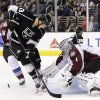 Photo - Colorado Avalanche goalie Semyon Varlamov, right, of Russia, makes a save in front of Los Angeles Kings' Kyle Clifford during the second period of an NHL hockey game on Saturday, Nov. 23, 2013, in Los Angeles.(AP Photo/Jae C. Hong)
