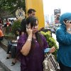 Indonesian women make phone calls as they are evacuated from a shopping mall after a strong earthquake was felt in Medan, Sumatra island, Indonesia, Wednesday, April 11, 2012. A massive earthquake off Indonesia\'s western coast triggered a tsunami watch for countries across the Indian Ocean on Wednesday, clogging streets with traffic as residents fled to high ground in cars and on the backs of motorcycles. (AP Photo/Binsar Bakkara)
