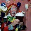 FILE - In this June 18, 1985, file photo, Ernest Borgnine holds a giant cupcake dressed as a clown in Los Angeles, for the revival of the Great Circus Parade in Milwaukee. A spokesman said Sunday, July 8, 2012, that Borgnine has died at the age of 95. (AP Photo/Robert Gabriel, File) ORG XMIT: NY807