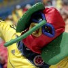 A Colombian supporter sports outrageous headwear before the group C World Cup soccer match between Colombia and Ivory Coast at the Estadio Nacional in Brasilia, Brazil, Thursday, June 19, 2014. (AP Photo/Marcio Jose Sanchez)
