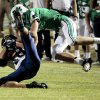 El Reno\'s Seth Jones catches a pass and is tackled by McGuinness\' Cody Chancellor as the Indians play the Bishop McGuinness Fighting Irish in high school football on Friday, Sept. 21, 2012 in Oklahoma City, Okla. Photo by Steve Sisney, The Oklahoman