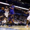 Oklahoma City\'s Russell Westbrook passes the ball around New York\'s Ronny Turiaf during the NBA basketball game between the Oklahoma City Thunder and the New York Knicks at the Oklahoma City Arena in Oklahoma City on Saturday, January 22, 2011. Photo by Bryan Terry, The Oklahoman ORG XMIT: KOD