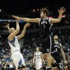 Brooklyn Nets\' Brook Lopez, right, hits Minnesota Timberwolves\' Greg Stiemsma\'s hand while trying to block a shot in the first half of an NBA basketball game on Wednesday, Jan. 23, 2013, in Minneapolis. (AP Photo/Jim Mone)