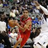 Houston Rockets guard Kevin Martin (12) drives against Dallas Mavericks\' O.J. Mayo (32) in the first half of a preseason NBA basketball game, Monday, Oct. 15, 2012, in Dallas. Martin scored 23 points in their 123-104 loss to the Mavericks. (AP Photo/Tony Gutierrez) ORG XMIT: DNA112