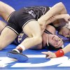 Oklahoma State\'s Alex Dieringer, back, takes on Drexel\'s Austin Sommer in the 157 pound match during the 2014 NCAA Div. 1 Wrestling Championships at Chesapeake Energy Arena in Oklahoma City, Okla. on Thursday, March 20, 2014. Photo by Chris Landsberger, The Oklahoman