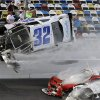 Kyle Larson (32) goes airborne and into the catch fence during a multi-car crash involving Justin Allgaier (31), Brian Scott (2) and others during the final lap of the NASCAR Nationwide Series auto race at Daytona International Speedway, Saturday, Feb. 23, 2013, in Daytona Beach, Fla. Larson\'s crash sent car parts and other debris flying into the stands injuring spectators. (AP Photo/John Raoux)