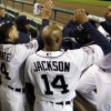 Detroit Tigers designated hitter Delmon Young, right, celebrates in the dugout after hitting a solo home run during the sixth inning of Game 4 of baseball\'s World Series Sunday, Oct. 28, 2012, in Detroit. (AP Photo/Matt Slocum)