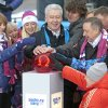 Moscow\'s Mayor Sergei Sobyanin, center, surrounded by various officials, sport enthusiasts and entertainers hits a symbolic button to launch the one-year count down clock for the upcoming 2014 Sochi Olympics, in Moscow, Russia, Thursday, Feb. 7, 2013. (AP Photo/Mikhail Metzel)
