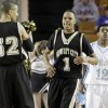 Photo - Midwest City's Trez Colbert (1), middle, and Xavier McClish (32) react in front of Kevin House of Putnam City West late in the fourth quarter during the Class 6A boys high school basketball state tournament semifinal game between Midwest City and Putnam City West at the ORU Mabee Center in Tulsa, Okla., Friday, March 12, 2010. Midwest City won, 50-47. Photo by Nate Billings, The Oklahoman
