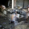 Indian migrant daily wage workers bath at a public tube well on a hot morning in New Delhi, India, Tuesday, May 17, 2016. Scorching summer temperatures, hovering well over 40 degrees Celsius (104 degrees Fahrenheit), are making life extremely tough for millions of poor people across north India. Without access to air coolers or air conditioning and sometimes even an electric fan, they struggle to cope with the heat in their inadequate homes. (AP Photo/Altaf Qadri)