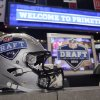 A helmet with the NFL football draft logo is placed on a table before the first round, Thursday, April 25, 2013, at Radio City Music Hall in New York. (AP Photo/Mary Altaffer) ORG XMIT: NYMA104