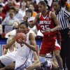 Amanda Thompson tries to save a pass in front of Angel McCoughtry in the first half as the University of Oklahoma plays Louisville at the 2009 NCAA women\'s basketball tournament Final Four in the Scottrade Center in Saint Louis, Missouri on Sunday, April 5, 2009. Photo by Steve Sisney, The Oklahoman