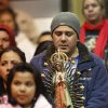 Noe Rodriguez holds a statue of Our Lady of Guadalupe as he joins his family and other worshipers during the service. In front, holding a smaller statue, is his daughter, Anilette, Rojo, 8. Many Hispanic parishioners attend a midnight service at Sacred Heart Church in southwest Oklahoma City to celebrate the Catholic Church\'s liturgical feast of Our Lady of Guadalupe on Thursday, Dec. 12, 2013. The service was a joyous and reverent celebration of traditions that commemorates the apparitions of Our Lady of Guadalupe in 1531 to a Mexican peasant Indian San Juan Diego and incorporates the customs and traditions of the Piro and Tigua ancestors of the village. It was filled with color, music and pageantry. Before and after the Mass, costumed dancers perform traditional Indian and Danzante dances. Photo by Jim Beckel, The Oklahoman