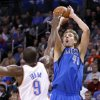 Photo - Dallas Mavericks forward Dirk Nowitzki (41) shoots over Oklahoma City Thunder forward Serge Ibaka during the second quarter of an NBA basketball game in Oklahoma City, Thursday, Dec. 27, 2012. (AP Photo/Alonzo Adams)