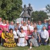 """Members of Edmond\'s Teacup Chains Square Dance Club pose in front of the square dance statue at the Oklahoma State Fair. The statue, named """"Promenade"""", is the only statue in the world dedicated to square dancing. For more information on the club, go to www.teacupchains.com. Community Photo By: Michelle Schaefer Submitted By: Michelle, Edmond"""