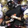 Douglass\' Diontay Washington is brought down by Oologah\'s John Vansingel, left, and Teddy Keys during a high school football playoff game in Oklahoma City, Friday, Nov. 19, 2010. Photo by Bryan Terry, The Oklahoman