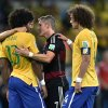 Germany\'s Bastian Schweinsteiger, centre, consoles Brazil\'s Dante and David Luiz, right, after the World Cup semifinal soccer match between Brazil and Germany at the Mineirao Stadium in Belo Horizonte, Brazil, Tuesday, July 8, 2014. Germany won the match 7-1. (AP Photo/Martin Meissner)