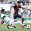 Barcelona\'s Marc Bartra duels for the ball with Elche\'s Domingo Cisma Gonzalez during a Spanish La Liga soccer match at the Martinez Valero stadium in Elche, Spain, on Sunday, May 11, 2014. (AP Photo/Alberto Saiz)