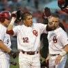 Oklahoma\'s Hector Lorenzana, center, is greeted by teammates including Colt Bickerstaff, left, and Hunter Haley, right, after scoring against Oklahoma State during a college baseball game Friday, May 10, 2013, in Tulsa, Okla. (AP Photo/Tulsa World, Matt Barnard) ORG XMIT: OKTUL306