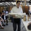 Photo -   FILE- In this Saturday May, 21, 2011, file photo, Mitt Romney arrives with lunch to speak with a group of small business owners on the economy during a visit to Meetze plumbing in Irmo, S.C. In an election year when the economy and small business have combined to form a huge campaign issue, advocacy groups like the Small Business & Entrepreneurship Council step up their own campaigns on behalf of the company owners they represent.(AP Photo/Mary Ann Chastain, File)