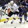 St. Louis Blues\' Alex Pietrangelo (27) and Los Angeles Kings\' Jordan Nolan (71) reach for a loose puck during the first period of Game 1 of their first-round NHL hockey Stanley Cup playoff series, Tuesday, April 30, 2013, in St. Louis. (AP Photo/Bill Boyce)