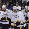 Photo - Nashville Predators' Shea Weber (6), Colin Wilson (33), Craig Smith (15) and Eric Nystrom celebrate a goal by Weber during the second period of an NHL hockey game against the Buffalo Sabres in Buffalo, N.Y., Tuesday, March 11, 2014. (AP Photo/Gary Wiepert)