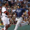 Tampa Bay Rays\' Evan Longoria runs home to score next to Boston Red Sox catcher Jarrod Saltalamacchia, on a single by Wil Myers during the third inning of a baseball game at Fenway Park in Boston on Wednesday, July 24, 2013. (AP Photo/Elise Amendola)