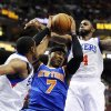 New York Knicks\' Carmelo Anthony (7) drives between Philadelphia 76ers\' Thaddeus Young (21) and Dorell Wright (4) in the first half of an NBA basketball game, Monday, Nov. 5, 2012, in Philadelphia. (AP Photo/Michael Perez)