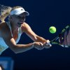 Photo - Caroline Wozniacki of Denmark makes a backhand return to  Lourdes Dominguez Lino of Spain during their first round match at the Australian Open tennis championship in Melbourne, Australia, Tuesday, Jan. 14, 2014.(AP Photo/Rick Rycroft)