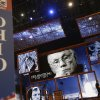Photo -   Behind the Ohio state delegate sign, pictures of Ohio native Neil Armstrong, the first man to walk on the moon, are displayed on the main stage the Republican National Convention in Tampa, Fla., on Sunday, Aug. 26, 2012. Armstrong died on Saturday. (AP Photo/David Goldman)