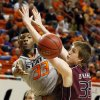 OSU\'s Marcus Smart (33) passes the ball around Bruce Marshall (35) of Missouri State during a men\'s college basketball between Oklahoma State University and Missouri State at Gallagher-Iba Arena in Stillwater, Okla., Saturday, Dec. 8, 2012. Photo by Nate Billings, The Oklahoman