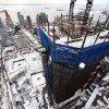 FILE - In this Jan. 27, 2011 file photo, snow covers the World Trade Center construction site in New York. The tower under construction at right is One World Trade Center. (AP Photo/Mark Lennihan, File)