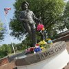 Flowers rest on the statue of James Garner on Main St. in downtown Norman, Okla., Sunday, July 20, 2014. Garner died Saturday at age 86. Photo by Nate Billings, The Oklahoman