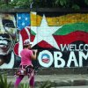 A woman takes a photo of a wall painting created by Myanmar graffiti artists to welcome U.S. President Barack Obama on a street in Yangon, Myanmar, Saturday, Nov. 17, 2012. Obama will visit Myanmar on Monday, in a first for a sitting U.S. president. White House officials on Thursday said he will use his visit