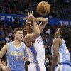Oklahoma City\'s Thabo Sefolosha (2) looses the ball between Denver\'s Danilo Gallinari (8) and Kenneth Faried (35) during the NBA basketball game between the Oklahoma City Thunder and the Denver Nuggets at the Chesapeake Energy Arena on Wednesday, Jan. 16, 2013, in Oklahoma City, Okla. Photo by Chris Landsberger, The Oklahoman