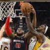 Photo - Detroit Pistons forward Greg Monroe, center, battles for a rebound with Los Angeles Lakers center Jordan Hill, right, and center Pau Gasol, of Spain, during the first half of an NBA basketball game Sunday, Nov. 17, 2013, in Los Angeles. (AP Photo/Mark J. Terrill)