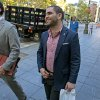 Photo - Charles Shrem, center, the top executive of a New York City-based Bitcoin company, walks from the federal court house in New York Thursday, Sept. 4, 2014, after pleading guilty to federal charges that he helped smooth the way for drug transactions on the online marketplace Silk Road. (AP Photo/Craig Ruttle)